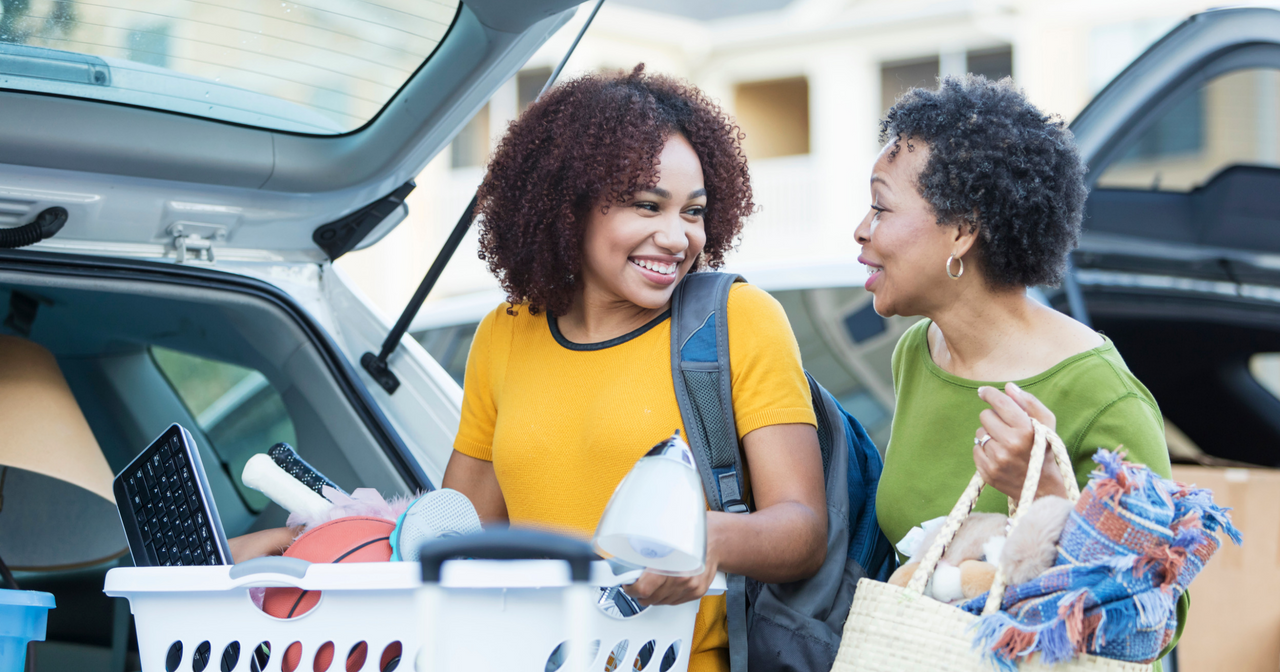 A mother helps her daughter pack the car to go to college