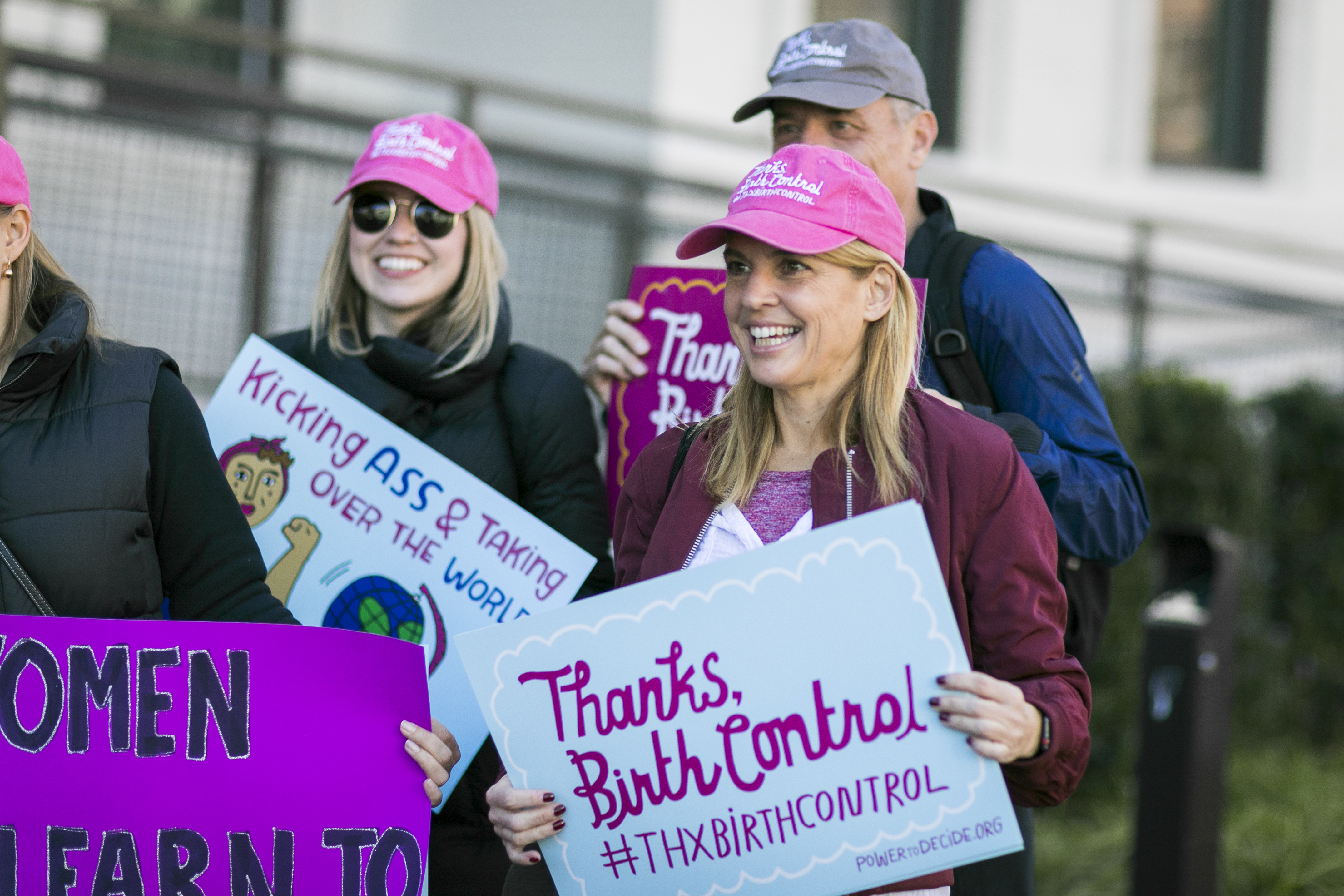 "Power to Decide CEO at a rally with a sign that reads, ""Thanks, Birth Control #ThxBirthControl"""