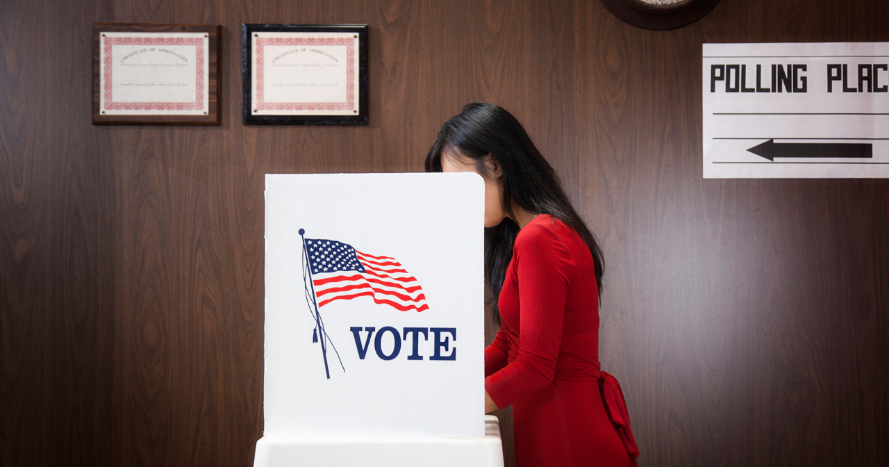 A woman voting in a booth