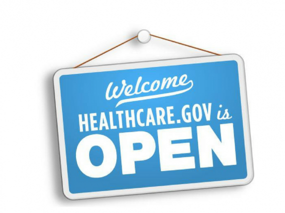 A graphic of a sign saying open enrollment is open