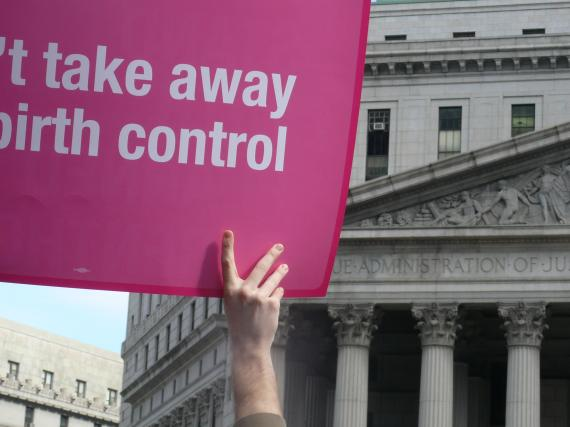 "a woman holding a sign that reads, ""Don't take away my birth control"""
