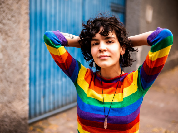 A woman in a rainbow shirt