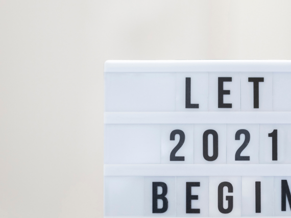 "A lightboard with the words, ""Let 2021 Begin"""