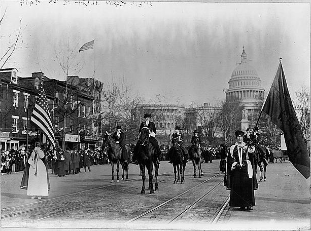 Women suffragists marching on Pennsylvania Avenue led by Mrs. Richard Coke Burleson in 1913.